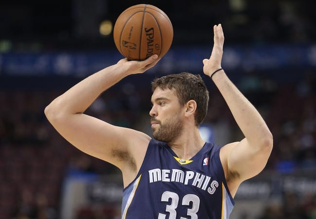 Oct 23, 2013; Toronto, Ontario, CAN; Memphis Grizzlies center Marc Gasol (33) looks to pass the ball against the Toronto Raptors at Air Canada Centre. The Raptors beat the Grizzlies 108-72. Mandatory Credit: Tom Szczerbowski-USA TODAY Sports