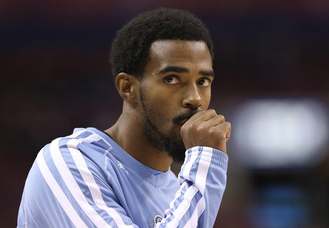 Oct 23, 2013; Toronto, Ontario, CAN; Memphis Grizzlies point guard Mike Conley (11) warms up before playing against the Toronto Raptors at Air Canada Centre. The Raptors beat the Grizzlies 108-72. Mandatory Credit: Tom Szczerbowski-USA TODAY Sports