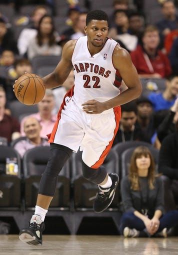 Oct 23, 2013; Toronto, Ontario, CAN; Toronto Raptors forward Rudy Gay (22) dribbles up the court against the Memphis Grizzlies at Air Canada Centre. The Raptors beat the Grizzlies 108-72. Mandatory Credit: Tom Szczerbowski-USA TODAY Sports