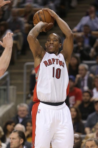 Oct 23, 2013; Toronto, Ontario, CAN; Toronto Raptors guard DeMar DeRozan (10) hits a three-pointer against the Memphis Grizzlies at Air Canada Centre. The Raptors beat the Grizzlies 108-72. Mandatory Credit: Tom Szczerbowski-USA TODAY Sports