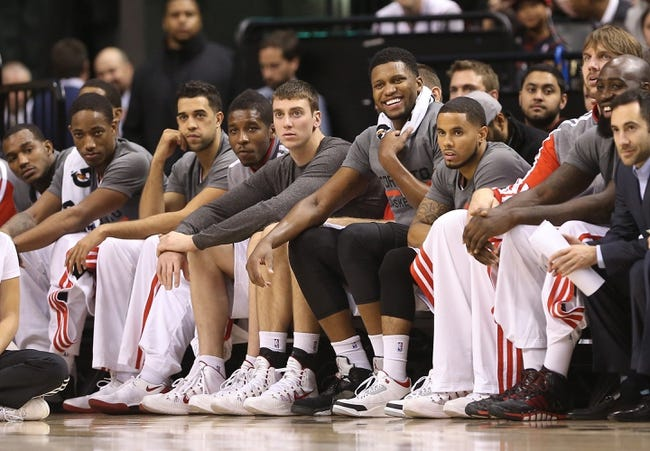 Oct 23, 2013; Toronto, Ontario, CAN; Toronto Raptors guard Carlos Morais (6) and guard DeMar DeRozan (10) and forward Landry Fields (2) and guard Dwight Buycks (13) and forward Tyler Hansbrough (50) and forward Rudy Gay (22) and point guard D.J. Augustin (14) and center Aaron Gray (34) and forward Quincy Acy (4) look on from the bench against the Memphis Grizzlies at Air Canada Centre. The Raptors beat the Grizzlies 108-72. Mandatory Credit: Tom Szczerbowski-USA TODAY Sports