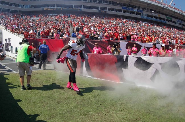 Oct 13, 2013; Tampa, FL, USA; Tampa Bay Buccaneers outside linebacker Lavonte David (54) runs out of the tunnel before the game against the Philadelphia Eagles at Raymond James Stadium. Mandatory Credit: Kim Klement-USA TODAY Sports