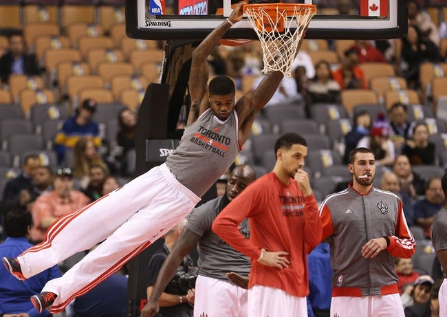 Oct 23, 2013; Toronto, Ontario, CAN; Toronto Raptors center Amir Johnson (15) warms up by swinging off the basket against the Memphis Grizzlies at Air Canada Centre. The Raptors beat the Grizzlies 108-72. Mandatory Credit: Tom Szczerbowski-USA TODAY Sports