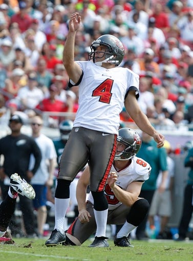 Oct 13, 2013; Tampa, FL, USA; Tampa Bay Buccaneers kicker Rian Lindell (4) kicks a field goal against the Philadelphia Eagles during the first half at Raymond James Stadium. Mandatory Credit: Kim Klement-USA TODAY Sports