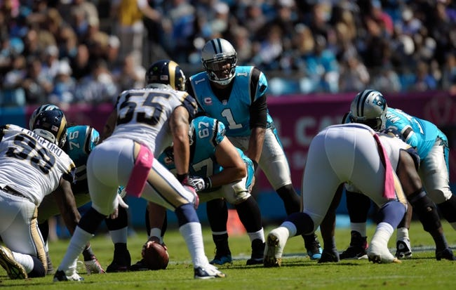 Oct 20, 2013; Charlotte, NC, USA; Carolina Panthers quarterback Cam Newton (1) prepares to take the snap during the game against the St. Louis Rams at Bank of America Stadium. Panthers win 30-15. Mandatory Credit: Sam Sharpe-USA TODAY Sports