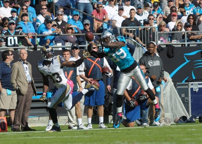 Oct 20, 2013; Charlotte, NC, USA; Carolina Panthers cornerback Drayton Florence (29) breaks up a pass intended for St. Louis Rams wide receiver Ben Quick (83) during the game at Bank of America Stadium. Panthers win 30-15. Mandatory Credit: Sam Sharpe-USA TODAY Sports
