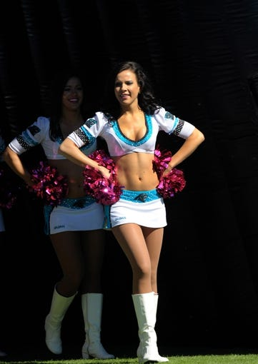 Oct 20, 2013; Charlotte, NC, USA; Carolina Panthers cheerleader waits to take the field before the game against the St. Louis Rams at Bank of America Stadium. Panthers win 30-15. Mandatory Credit: Sam Sharpe-USA TODAY Sports