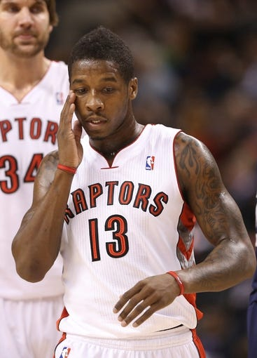 Oct 23, 2013; Toronto, Ontario, CAN; Toronto Raptors guard Dwight Buycks (13) against the Memphis Grizzlies at Air Canada Centre. The Raptors beat the Grizzlies 108-72. Mandatory Credit: Tom Szczerbowski-USA TODAY Sports