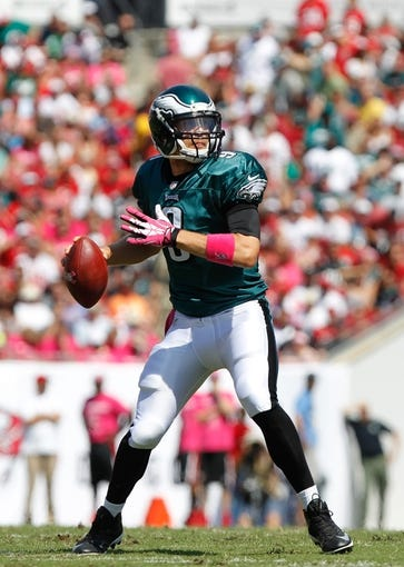Oct 13, 2013; Tampa, FL, USA; Philadelphia Eagles quarterback Nick Foles (9) throws the ball during the first quarter against the Tampa Bay Buccaneers at Raymond James Stadium. Mandatory Credit: Kim Klement-USA TODAY Sports
