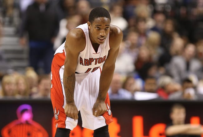 Oct 23, 2013; Toronto, Ontario, CAN; Toronto Raptors guard DeMar DeRozan (10) looks on against the Memphis Grizzlies at Air Canada Centre. The Raptors beat the Grizzlies 108-72. Mandatory Credit: Tom Szczerbowski-USA TODAY Sports