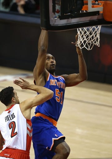 Oct 11, 2013; Toronto, Ontario, CAN; New York Knicks forward Metta World Peace (51) goes to the basket as Toronto Raptors forward Landry Fields (2) tries to defend at Air Canada Centre. The Raptors beat the Knicks 100-91. Mandatory Credit: Tom Szczerbowski-USA TODAY Sports