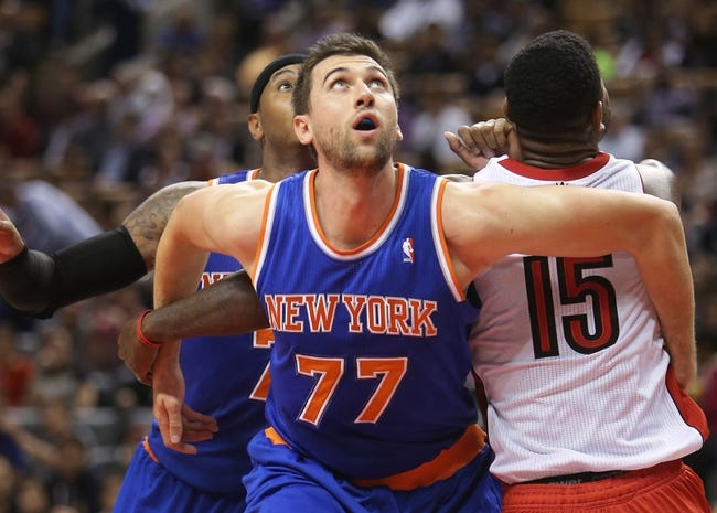 Oct 11, 2013; Toronto, Ontario, CAN; New York Knicks forward Andrea Bargnani (77) tries to box out Toronto Raptors center Amir Johnson (15) as he looks for a rebound at Air Canada Centre. The Raptors beat the Knicks 100-91. Mandatory Credit: Tom Szczerbowski-USA TODAY Sports