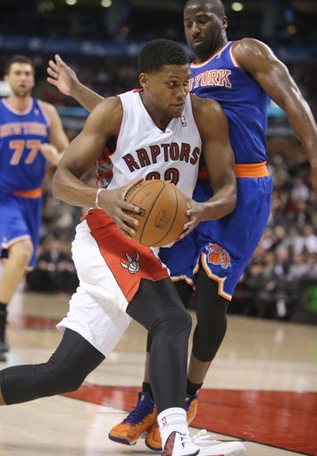 Oct 11, 2013; Toronto, Ontario, CAN; Toronto Raptors forward Rudy Gay (22) drives to the basket against New York Knicks point guard Raymond Felton (2) at Air Canada Centre. The Raptors beat the Knicks 100-91. Mandatory Credit: Tom Szczerbowski-USA TODAY Sports