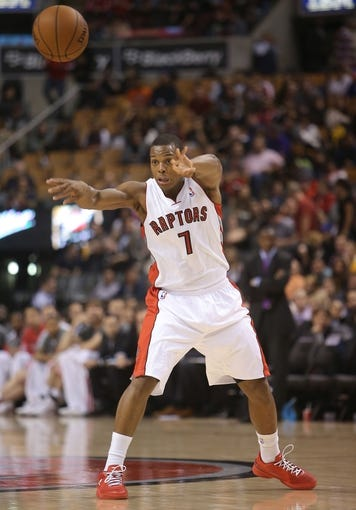 Oct 11, 2013; Toronto, Ontario, CAN; Toronto Raptors point guard Kyle Lowry (7) passes the ball against the New York Knicks at Air Canada Centre. The Raptors beat the Knicks 100-91. Mandatory Credit: Tom Szczerbowski-USA TODAY Sports