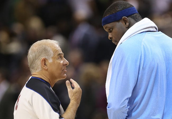 Oct 23, 2013; Toronto, Ontario, CAN; Referee Bennett Salvatore (15) talks to Memphis Grizzlies forward Zach Randolph (50) after ejecting him for a flagrant foul on Toronto Raptors center Jonas Valanciunas (not pictured) at Air Canada Centre. The Raptors beat the Grizzlies 108-72. Mandatory Credit: Tom Szczerbowski-USA TODAY Sports