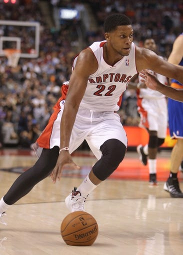 Oct 11, 2013; Toronto, Ontario, CAN; Toronto Raptors forward Rudy Gay (22) drives to the basket against the New York Knicks at Air Canada Centre. The Raptors beat the Knicks 100-91. Mandatory Credit: Tom Szczerbowski-USA TODAY Sports