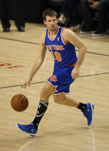 Oct 11, 2013; Toronto, Ontario, CAN; New York Knicks point guard Beno Udrih (18) dribbles the ball against the Toronto Raptors at Air Canada Centre. The Raptors beat the Knicks 100-91. Mandatory Credit: Tom Szczerbowski-USA TODAY Sports