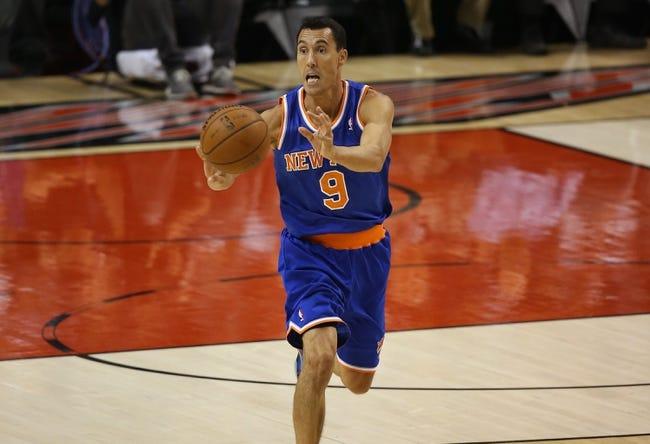 Oct 11, 2013; Toronto, Ontario, CAN; New York Knicks point guard Pablo Prigioni (9) passes the ball against the Toronto Raptors at Air Canada Centre. The Raptors beat the Knicks 100-91. Mandatory Credit: Tom Szczerbowski-USA TODAY Sports