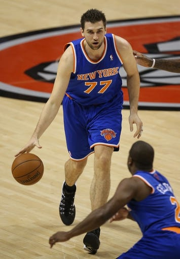 Oct 11, 2013; Toronto, Ontario, CAN; New York Knicks forward Andrea Bargnani (77) dribbles the ball against the Toronto Raptors at Air Canada Centre. The Raptors beat the Knicks 100-91. Mandatory Credit: Tom Szczerbowski-USA TODAY Sports