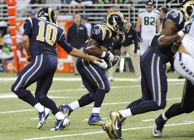 Oct 28, 2013; St. Louis, MO, USA; St. Louis Rams quarterback Kellen Clemens (10) hands the ball off to St. Louis Rams running back Zac Stacy (30) against the Seattle Seahawks during the second half at Edward Jones Dome. The Seahawks defeat the Rams 14-9. Mandatory Credit: Jasen Vinlove-USA TODAY Sports