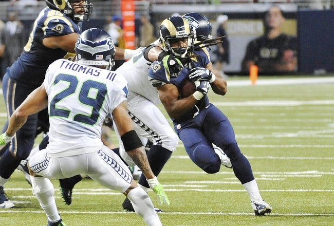 Oct 28, 2013; St. Louis, MO, USA; St. Louis Rams running back Daryl Richardson (26) runs the ball against the Seattle Seahawks during the second half at Edward Jones Dome. The Seahawks defeat the Rams 14-9. Mandatory Credit: Jasen Vinlove-USA TODAY Sports