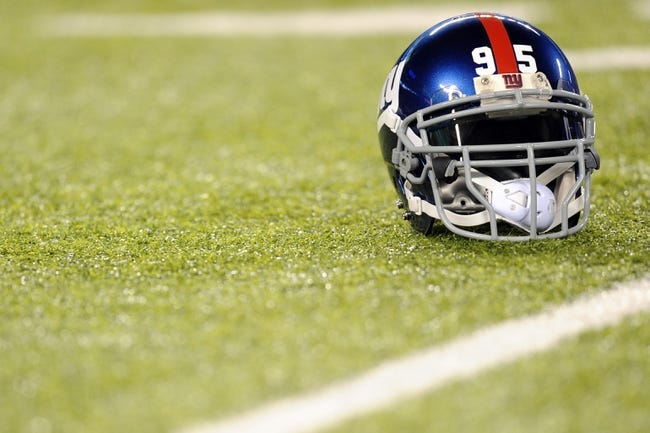 Oct 21, 2013; East Rutherford, NJ, USA; The helmet of New York Giants defensive tackle Shaun Rogers (95) lies on the field before facing the Minnesota Vikings at MetLife Stadium.  The Giants won the game 23-7. Mandatory Credit: Joe Camporeale-USA TODAY Sports