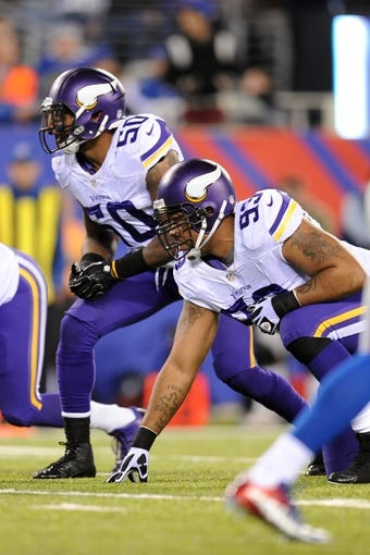 Oct 21, 2013; East Rutherford, NJ, USA; Minnesota Vikings middle linebacker Erin Henderson (50) and Minnesota Vikings defensive tackle Kevin Williams (93) line up for a play against the New York Giants at MetLife Stadium.  The Giants won the game 23-7. Mandatory Credit: Joe Camporeale-USA TODAY Sports