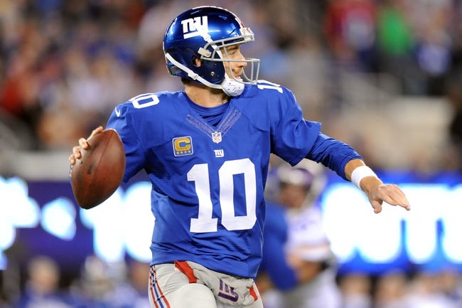 Oct 21, 2013; East Rutherford, NJ, USA; New York Giants quarterback Eli Manning (10) throws a pass against the Minnesota Vikings at MetLife Stadium. The Giants won the game 23-7. Mandatory Credit: Joe Camporeale-USA TODAY Sports