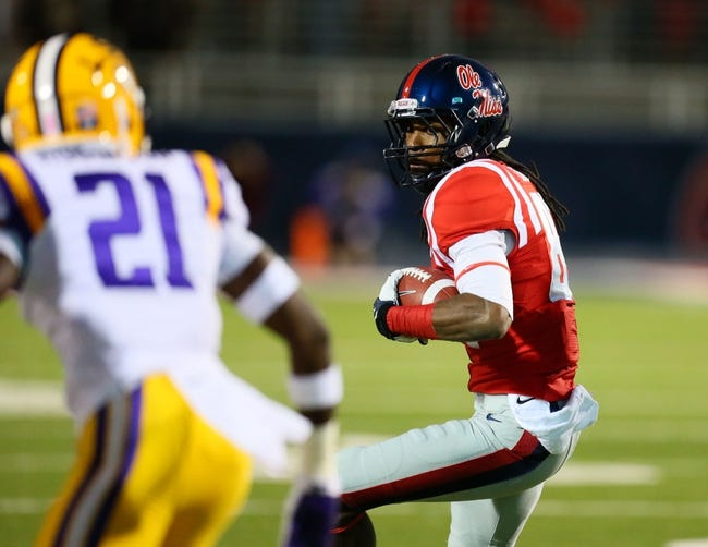 Oct 19, 2013; Oxford, MS, USA; Mississippi Rebels wide receiver Quincy Adeboyejo (8) advances the ball during the game against the LSU Tigers at Vaught-Hemingway Stadium. Mississippi Rebels defeat the LSU Tigers 27-24.  Mandatory Credit: Spruce Derden-USA TODAY Sports