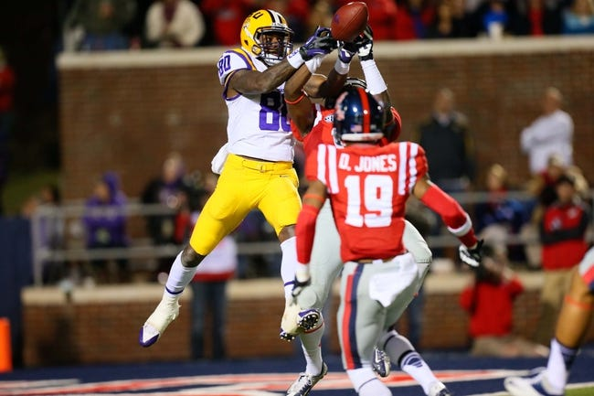 Oct 19, 2013; Oxford, MS, USA; LSU Tigers wide receiver Jarvis Landry (80) goes up for a pass during the game against the Mississippi Rebels at Vaught-Hemingway Stadium. Mississippi Rebels defeat the LSU Tigers 27-24.  Mandatory Credit: Spruce Derden-USA TODAY Sports