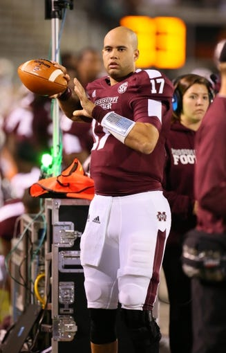 Oct 24, 2013; Starkville, MS, USA; Mississippi State Bulldogs quarterback Tyler Russell (17) warms up before the game against the Kentucky Wildcats at Davis Wade Stadium. Mississippi State Bulldogs win the game against Kentucky Wildcats 28-22.  Mandatory Credit: Spruce Derden-USA TODAY Sports