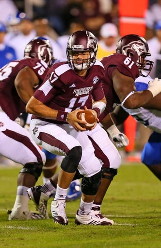 Oct 24, 2013; Starkville, MS, USA; Mississippi State Bulldogs quarterback Tyler Russell (17) prepares to hand the ball off during the game against the Kentucky Wildcats at Davis Wade Stadium. Mississippi State Bulldogs win the game against Kentucky Wildcats 28-22.  Mandatory Credit: Spruce Derden-USA TODAY Sports