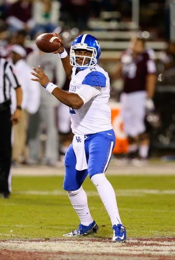 Oct 24, 2013; Starkville, MS, USA; Kentucky Wildcats quarterback Jalen Whitlow (2) passes the ball during the game against the Mississippi State Bulldogs at Davis Wade Stadium. Mississippi State Bulldogs win the game against Kentucky Wildcats 28-22.  Mandatory Credit: Spruce Derden-USA TODAY Sports