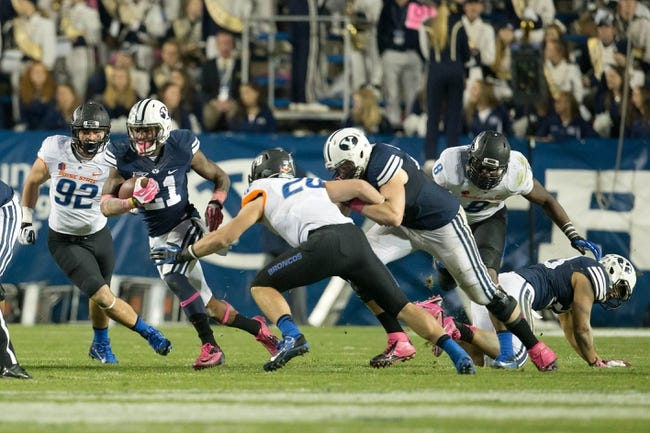 Oct 25, 2013; Provo, UT, USA; Brigham Young Cougars running back Jamaal Williams (21) runs with the ball during the second half against the Boise State Broncos at Lavell Edwards Stadium. Brigham Young won 37-20. Mandatory Credit: Russ Isabella-USA TODAY Sports