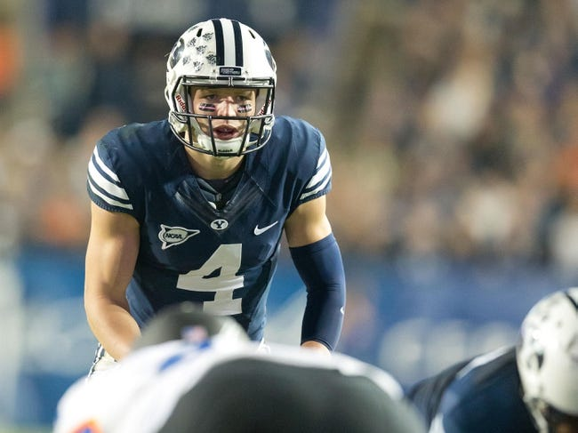 Oct 25, 2013; Provo, UT, USA; Brigham Young Cougars quarterback Taysom Hill (4) awaits the snap prior to a play during the first half against the Boise State Broncos at Lavell Edwards Stadium. Brigham Young won 37-20. Mandatory Credit: Russ Isabella-USA TODAY Sports