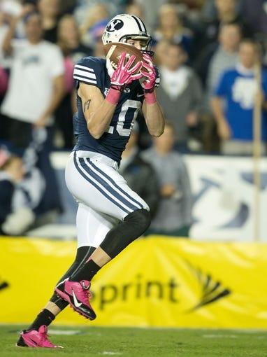Oct 25, 2013; Provo, UT, USA; Brigham Young Cougars wide receiver Mitch Mathews (10) catches a touchdown pass during the second half against the Boise State Broncos at Lavell Edwards Stadium. Brigham Young won 37-20. Mandatory Credit: Russ Isabella-USA TODAY Sports
