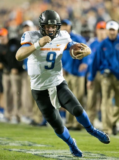 Oct 25, 2013; Provo, UT, USA; Boise State Broncos quarterback Grant Hedrick (9) runs with the ball during the second half against the Brigham Young Cougars at Lavell Edwards Stadium. Brigham Young won 37-20. Mandatory Credit: Russ Isabella-USA TODAY Sports