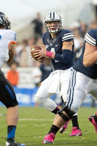 Oct 25, 2013; Provo, UT, USA; Brigham Young Cougars quarterback Taysom Hill (4) drops back to pass during the first half against the Boise State Broncos at Lavell Edwards Stadium. Brigham Young won 37-20. Mandatory Credit: Russ Isabella-USA TODAY Sports
