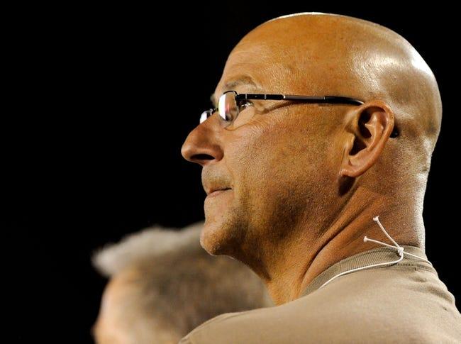 Oct 19, 2013; Tucson, AZ, USA; Arizona Wildcats alumni and Cleveland Indians manager Terry Francona watches the game from the sidelines during the third quarter against the Utah Utes at Arizona Stadium. Arizona beat Utah 35-44. Mandatory Credit: Casey Sapio-USA TODAY Sports