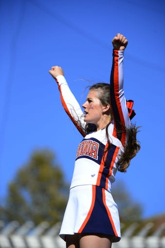 Oct 26, 2013; Charlottesville, VA, USA; Virginia Cavaliers cheerleader performs. The Georgia Tech Yellow Jackets defeated the Cavaliers 35-25 at Scott Stadium. Mandatory Credit: Bob Donnan-USA TODAY Sports