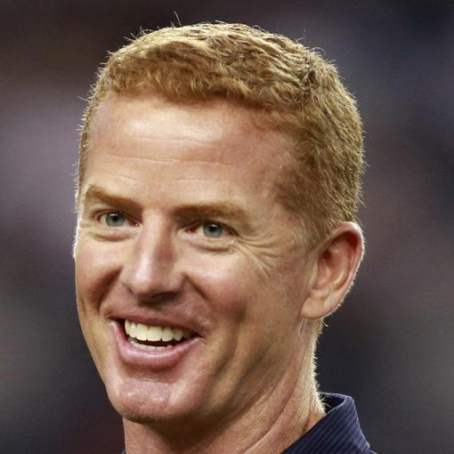 Oct 13, 2013; Arlington, TX, USA; Dallas Cowboys head coach Jason Garrett smiles while on the field prior to the game against the Washington Redskins at AT&T Stadium. Mandatory Credit: Tim Heitman-USA TODAY Sports