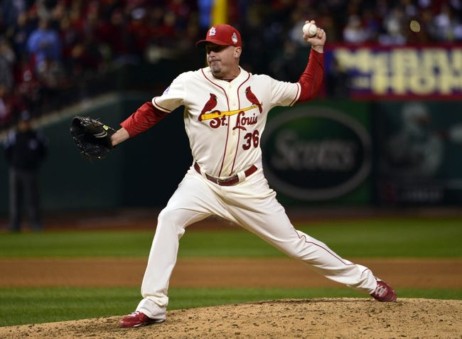 Oct 26, 2013; St. Louis, MO, USA; St. Louis Cardinals relief pitcher Randy Choate throws a pitch against the Boston Red Sox in the 6th inning during game three of the MLB baseball World Series at Busch Stadium. Mandatory Credit: Scott Rovak-USA TODAY Sports