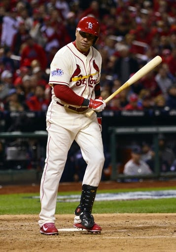 Oct 26, 2013; St. Louis, MO, USA; St. Louis Cardinals right fielder Carlos Beltran tosses his bat after being hit by a pitch in the seventh inning against the Boston Red Sox during game three of the MLB baseball World Series at Busch Stadium. Mandatory Credit: Scott Rovak-USA TODAY Sports