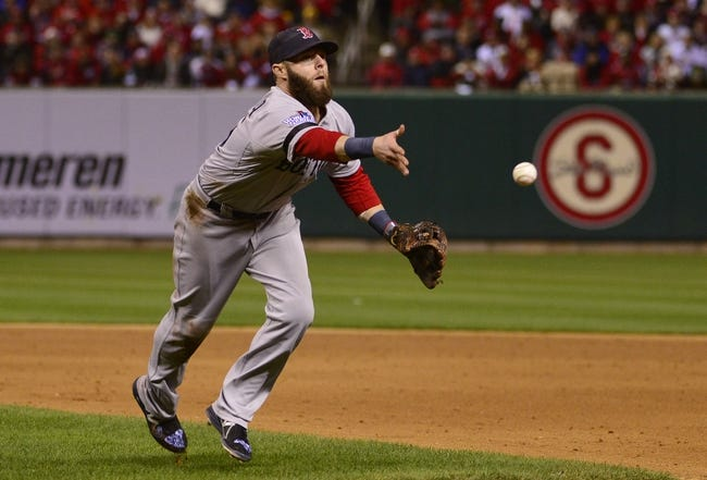 Oct 26, 2013; St. Louis, MO, USA; Boston Red Sox second baseman Dustin Pedroia tosses the ball to first base in the 6th inning during game three of the MLB baseball World Series against the St. Louis Cardinals at Busch Stadium. Mandatory Credit: Scott Rovak-USA TODAY Sports
