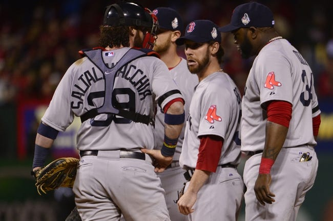 Oct 26, 2013; St. Louis, MO, USA; Boston Red Sox relief pitcher Craig Breslow (middle) waits to be relieved in the 7th inning against the St. Louis Cardinals during game three of the MLB baseball World Series at Busch Stadium. Mandatory Credit: Scott Rovak-USA TODAY Sports
