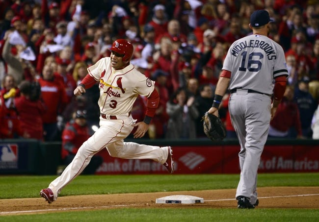 Oct 26, 2013; St. Louis, MO, USA; St. Louis Cardinals right fielder Carlos Beltran (3) scores a run against the Boston Red Sox in the 7th inningduring game three of the MLB baseball World Series at Busch Stadium. Mandatory Credit: Scott Rovak-USA TODAY Sports