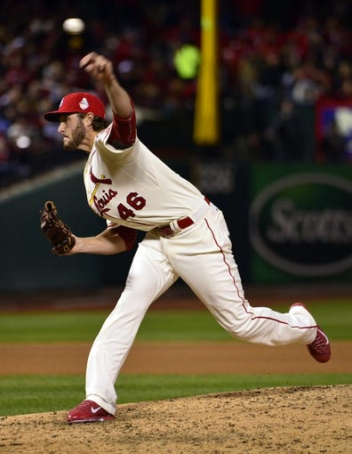 Oct 26, 2013; St. Louis, MO, USA; St. Louis Cardinals relief pitcher Kevin Siegrist throws a pitch against the Boston Red Sox in the 7th inning during game three of the MLB baseball World Series at Busch Stadium. Mandatory Credit: Scott Rovak-USA TODAY Sports