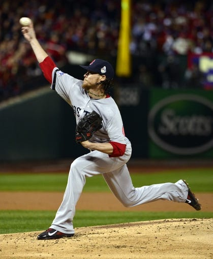 Oct 27, 2013; St. Louis, MO, USA; Boston Red Sox starting pitcher Clay Buchholz throws a pitch against the St. Louis Cardinals in the first inning during game four of the MLB baseball World Series at Busch Stadium. Mandatory Credit: Scott Rovak-USA TODAY Sports