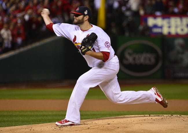 Oct 27, 2013; St. Louis, MO, USA; St. Louis Cardinals starting pitcher Lance Lynn throws a pitch against the Boston Red Sox in the first inning during game four of the MLB baseball World Series at Busch Stadium. Mandatory Credit: Scott Rovak-USA TODAY Sports