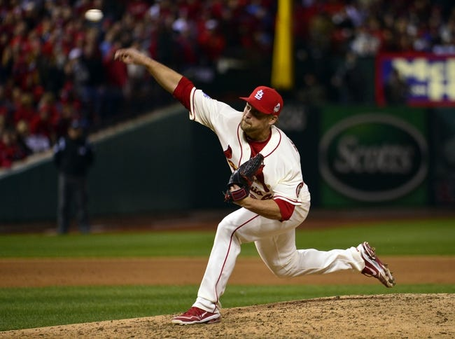 Oct 26, 2013; St. Louis, MO, USA; St. Louis Cardinals relief pitcher Trevor Rosenthal (26) throws a pitch against the Boston Red Sox in the 8th inning during game three of the MLB baseball World Series at Busch Stadium. Mandatory Credit: Scott Rovak-USA TODAY Sports